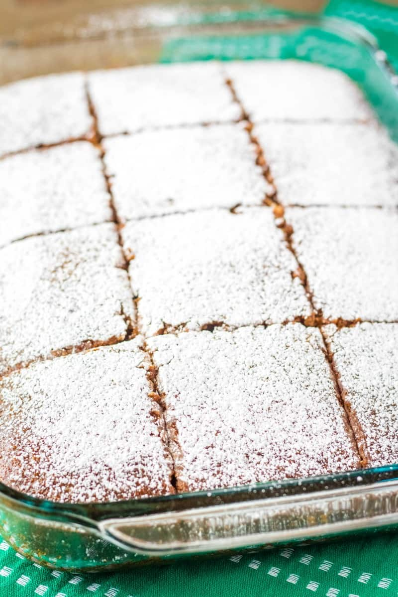 pan of guinness gingerbread topped with powdered sugar and cut into squares