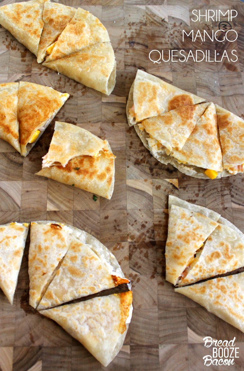 Shrimp Mango Quesadillas are an easy to make snack to one can resist! Serve 'em for dinner or a yummy party appetizer and watch them disappear!