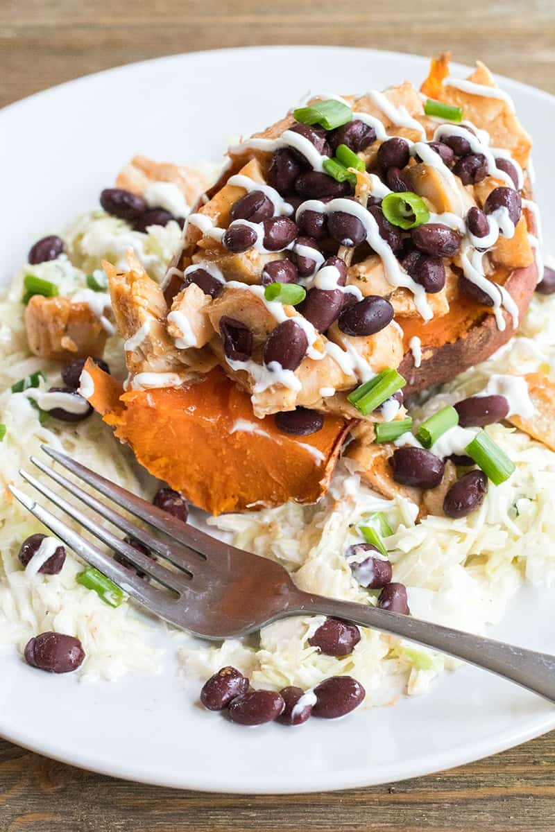 BBQ Chicken Stuffed Yams with Coleslaw is a healthy weeknight dinner that's loaded with flavor and is a sure-fire crowd pleaser!
