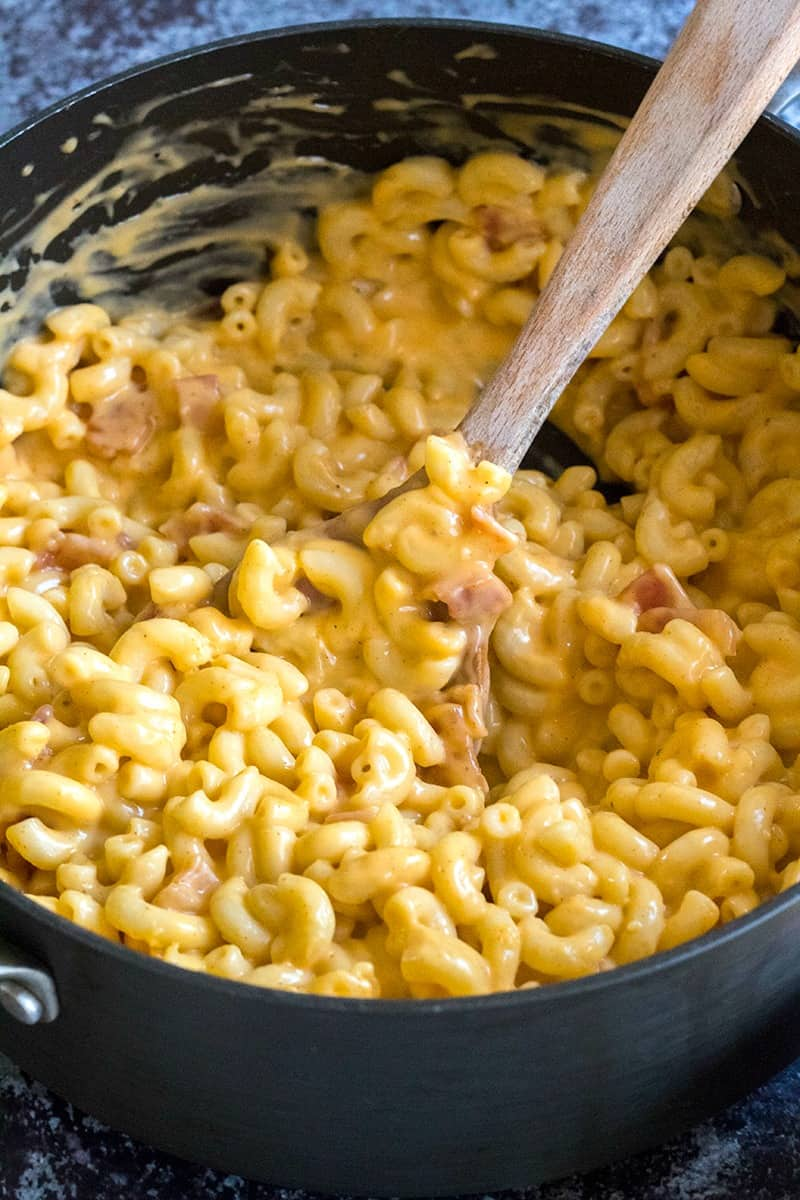 Whiskey and bacon come together for a killer dinner in this Jack Daniel's Bacon Mac and Cheese! Gooey & cheesy with sweet pops of candied bacon make this macaroni oh so crave-able!!