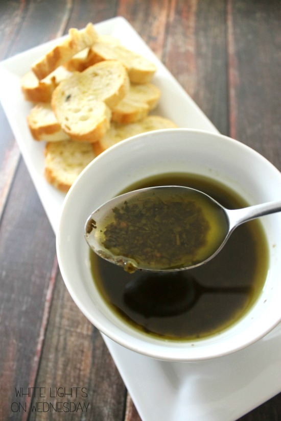 Pesto Dipping Oil is the best version of all those restaurant bread companions your get! Pesto, olive oil & balsamic marry together for a dip you'll love!