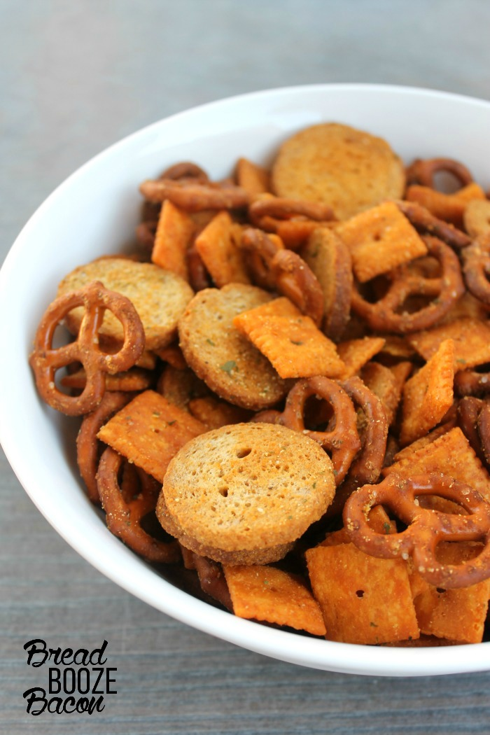 Spice up your next party with some Buffalo Ranch Snack Mix. It's easy to make, has a kick of heat, and is seriously addicting!