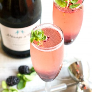 This Blackberry Mint Bellini is a creeper cocktail cleverly disguised as a posh brunch drink!
