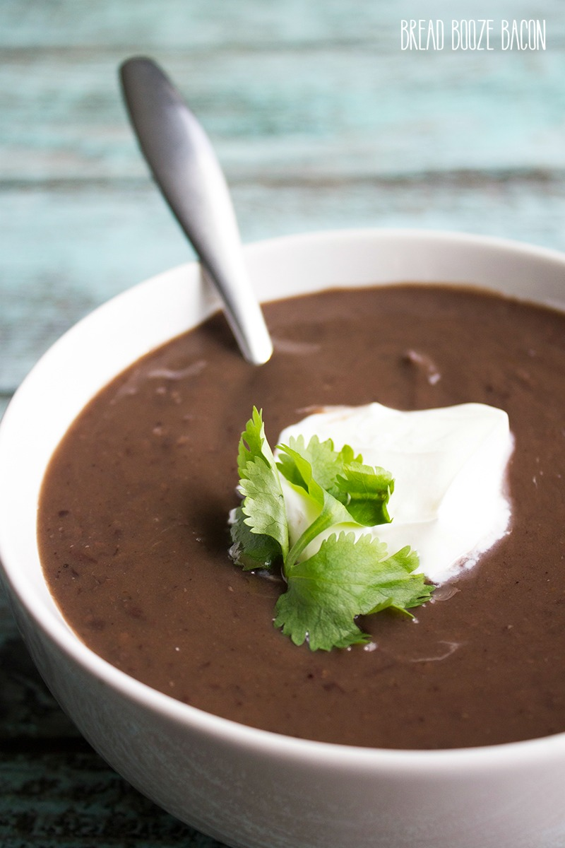 Creamy Slow Cooker Black Bean Soup is a comforting meal topped with sour cream for a dish that's fit for a restaurant!