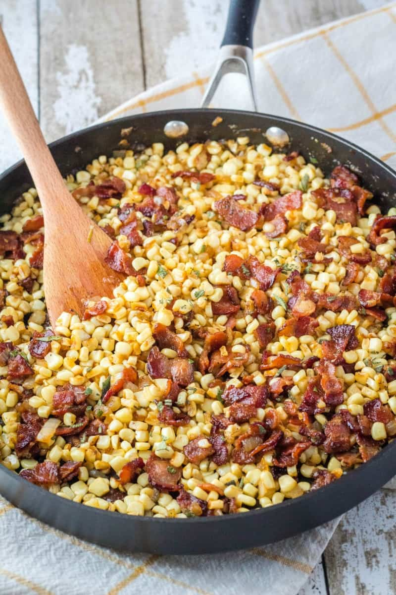 fried corn with bacon in a skillet