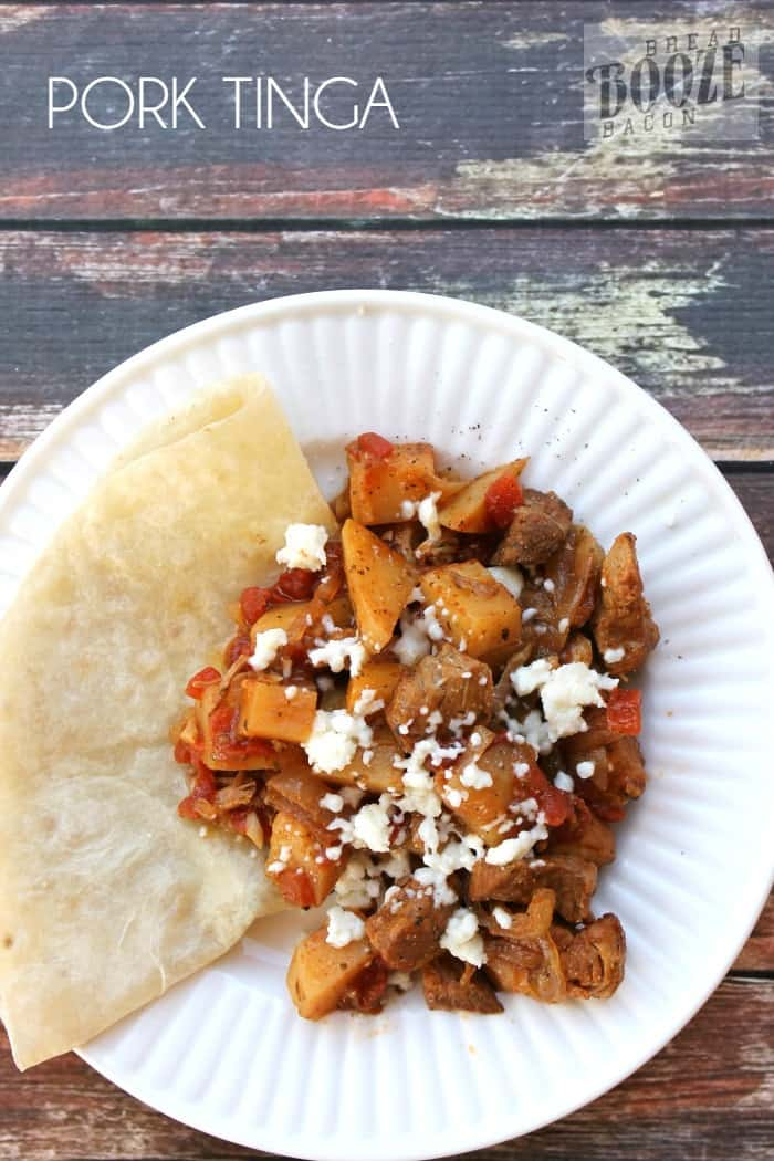 Slow cooker Pork Tinga is an easy to prepare dish that is bursting with flavor! It's one of my favorite dinners to make!