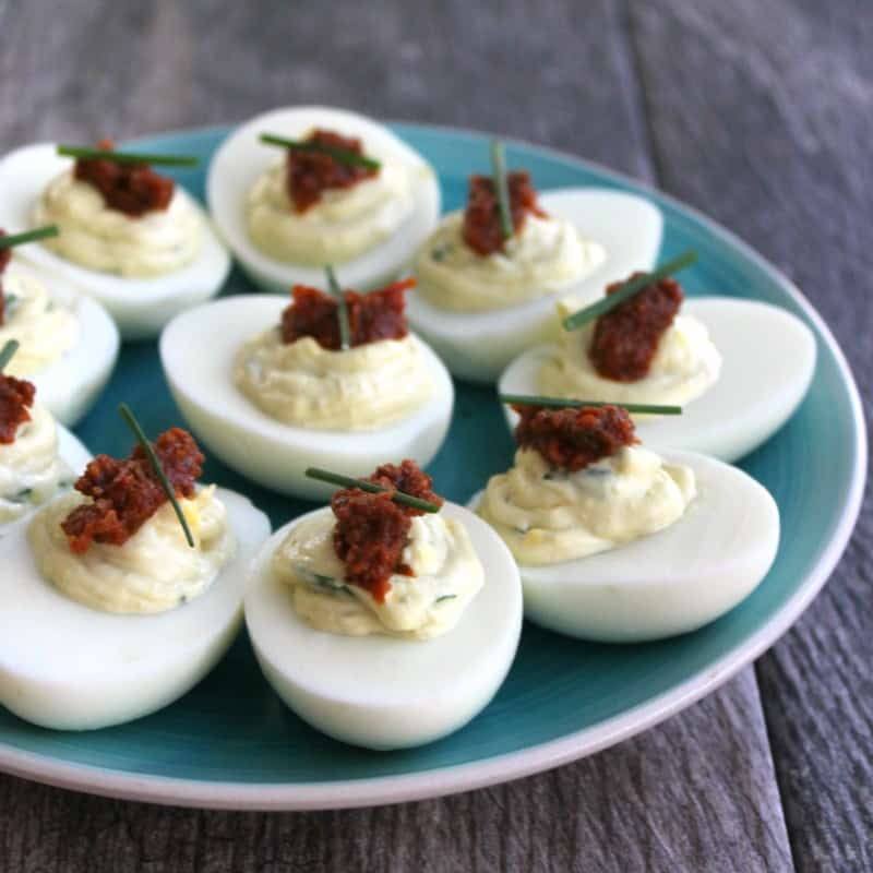 Three of my favorite flavors come together for a crave-able little bite in these Spinach & Sun Dried Tomato Deviled Eggs!