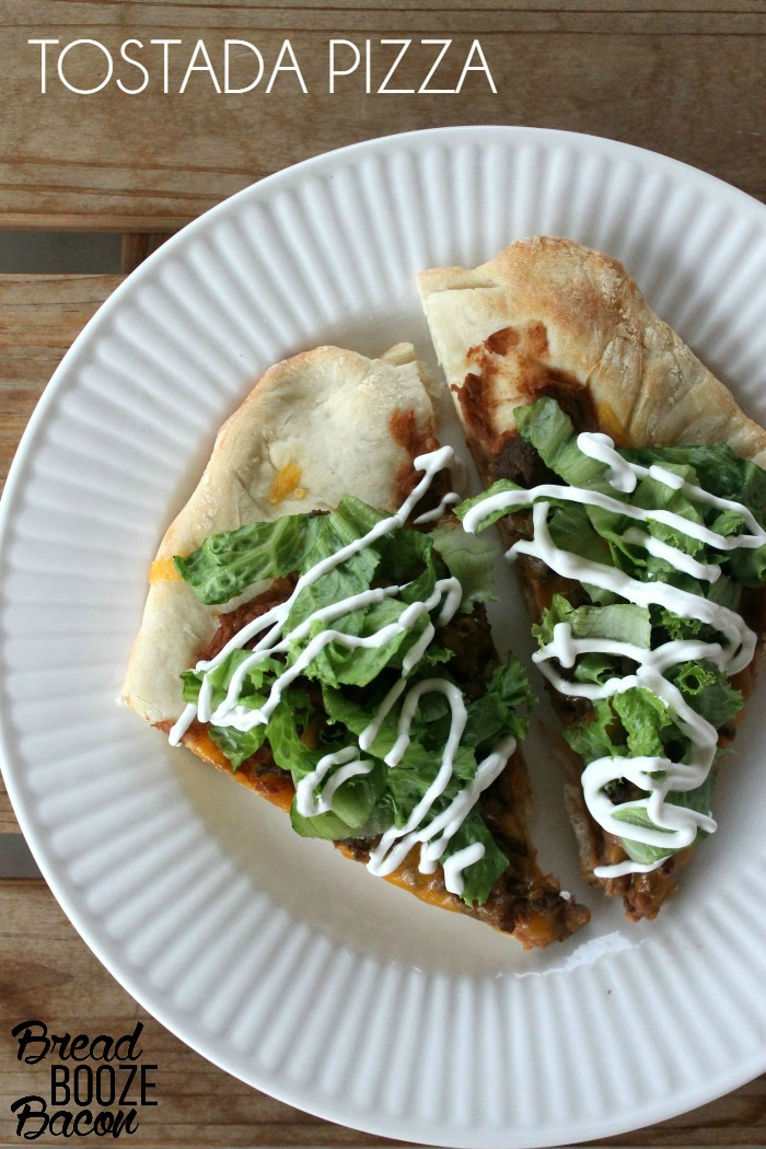 Tostada Pizza is an easy to make weeknight meal that's a total fusion of Taco Tuesday and Pizza Day!