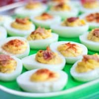Bacon + Roasted Garlic Deviled Eggs are addictive little bites of summer BBQ happiness!