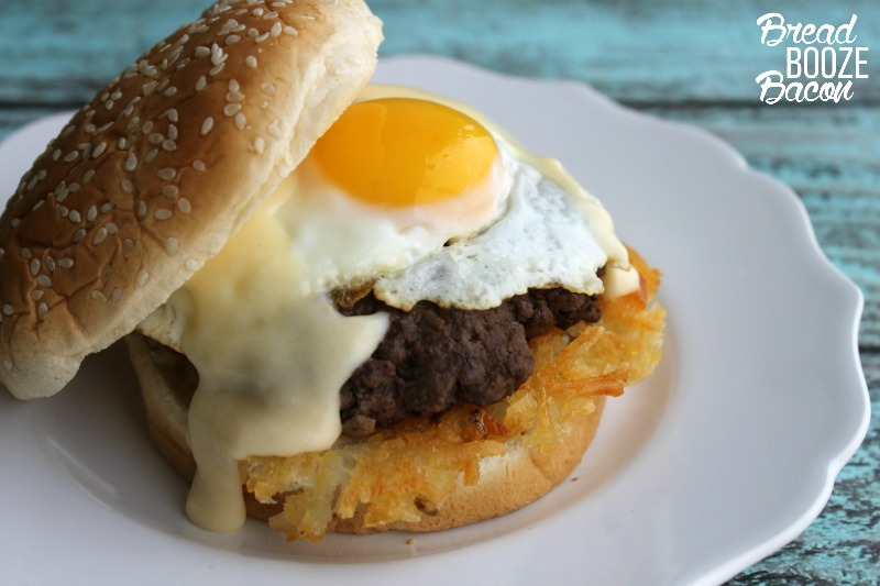 burger topped with sunny side up egg
