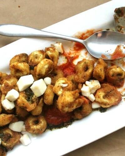 Fried Tortellini with Roasted Garlic Tomato Sauce & Pesto Oil