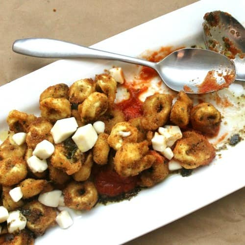 Fried Tortellini with Roasted Garlic Tomato Sauce + Pesto Oil