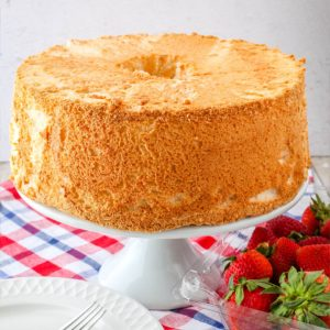 square iamge of angel food cake on a cake stand