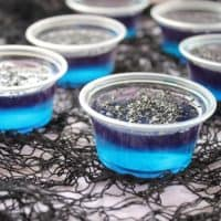 Black Magic Jello Shots are fun layered jello shots that are perfect for your Halloween party! Everyone will think they're magical!