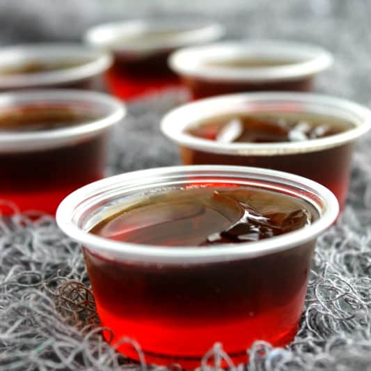 Dracula's Bite Jello Shots are a spiked cherry coke cocktail turned into Halloween party must make!