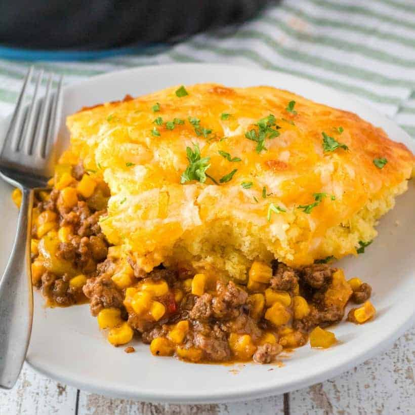Skillet Sloppy Joe Cornbread Casserole is a less messy way to enjoy a classic dish! It's an easy 30-minute meal that'll have your family asking for seconds!