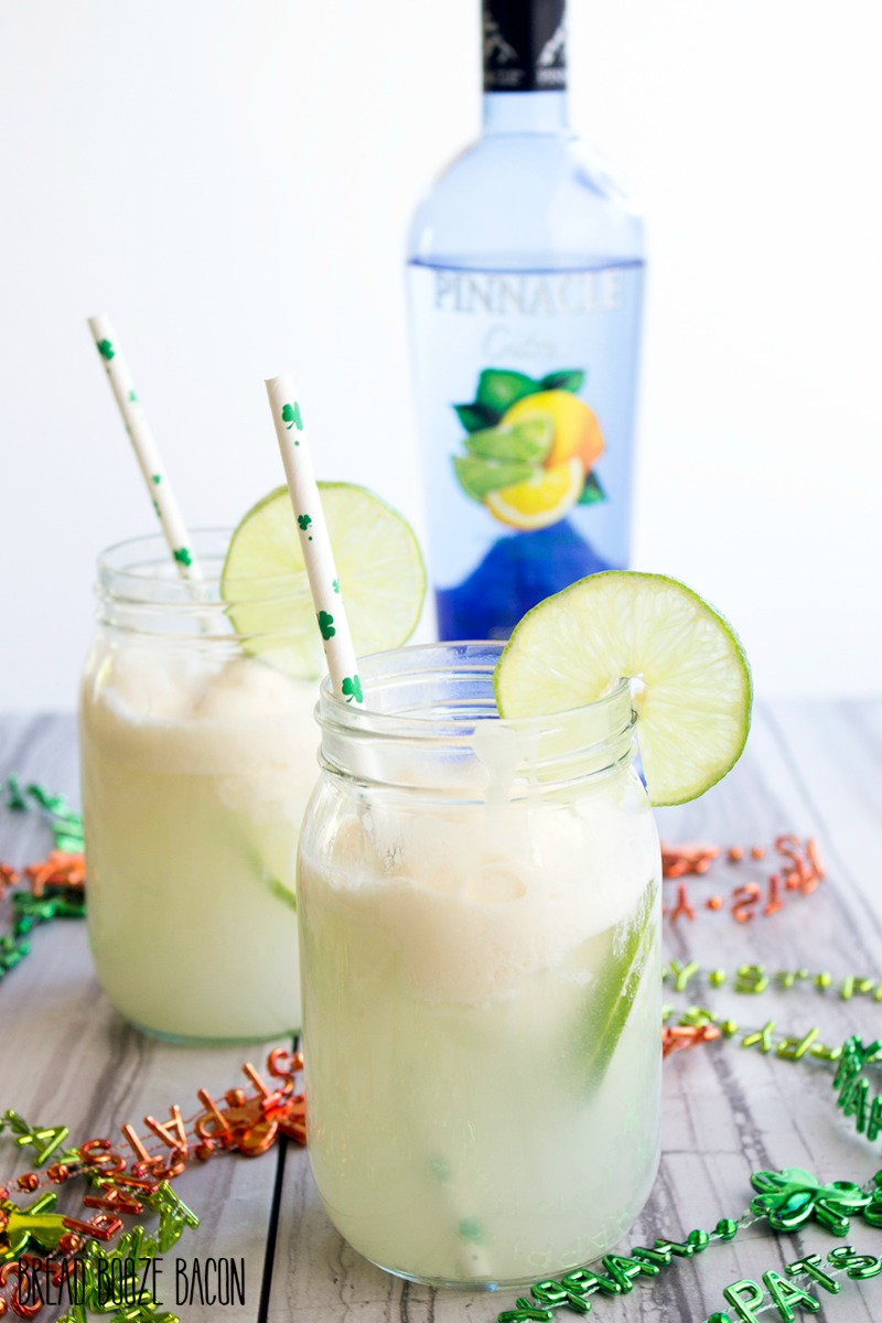 Forget creamsicles! Spiked Lime Ice Cream Soda is where it's at for a refreshing, citrusy cocktail! It's perfect for St. Patrick's Day or a warm day!