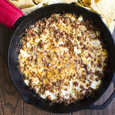 Take a trip to cheese town with this awesome Chorizo Queso Fundido! This cheesy, spicy dip is everything right about adding beer to your food!