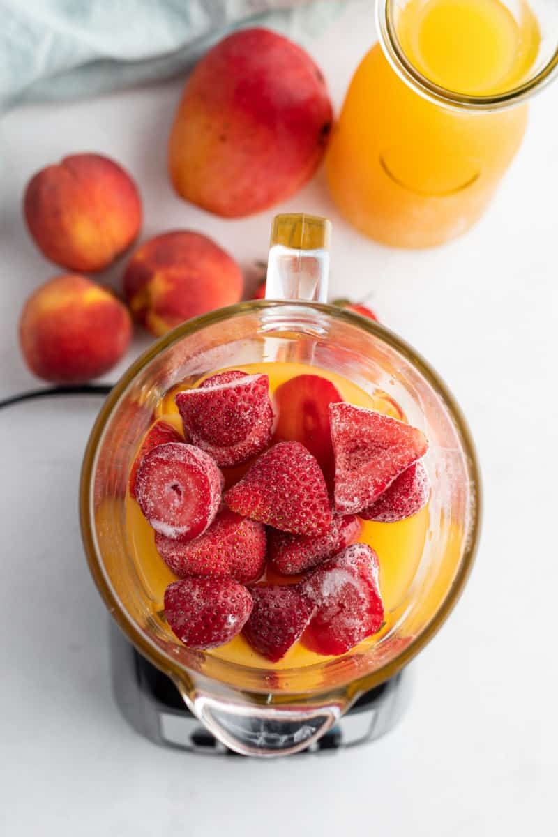 juice, frozen fruit and sherbet in a blender