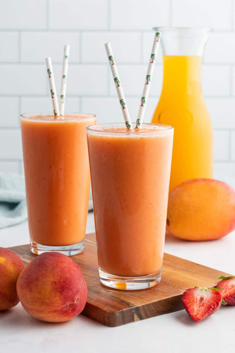 jamba juice caribbean passion smoothie copycat in glasses sitting on a board