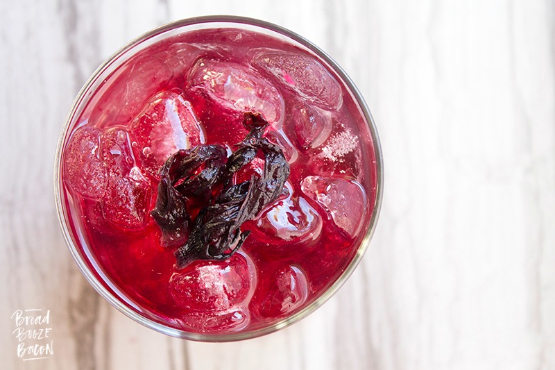Our Spiked Hibiscus Lemonade everything I love about serving a cocktail to guests. It's simple, delicious & absolutely gorgeous!