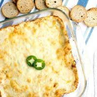 This Warm Jalapeno Crab Dip Recipe is a crave-able bite of cheesy, briny deliciousness that'll disappear right before your eyes!