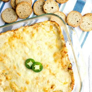 Warm Jalapeno Crab Dip Recipe is a crave-able bite of cheesy, briny deliciousness that'll disappear right before your eyes!