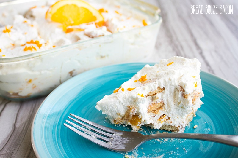 Orange Vanilla Icebox Cake tastes just like your favorite creamsicle popsicle! It's a no-bake dessert that's perfect for summer!