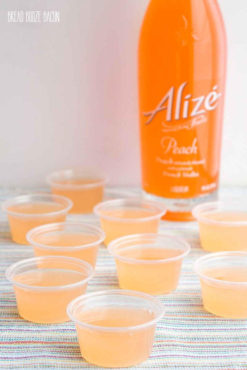 Peach Fizz Jello Shots are about to become your go-to summer cocktail! Super easy to make and crazy good, these shots disappear in a flash!