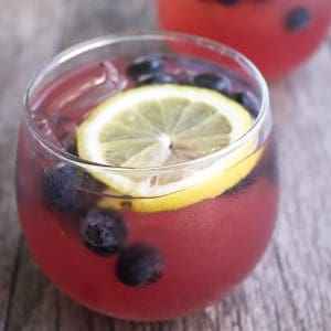 Day drinking is totally acceptable when it's Spiked Blackberry Lemonade Punch! This cocktail screams summer and is the perfect drink for your next cookout!