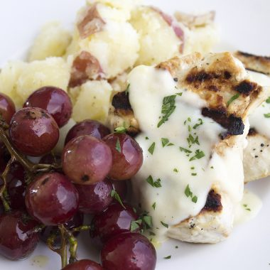 Grilled Garlic-Dijon Chicken & Grapes is easy enough for a weeknight dinner and sophisticated enough for company!