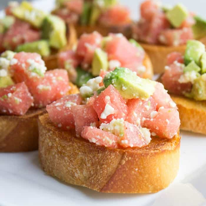 I love easy summer appetizers! This Watermelon & Avocado Bruschetta is light & refreshing for a flavor combination that's a delightful surprise!
