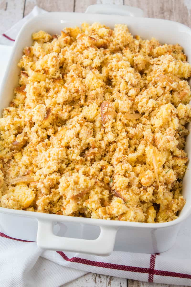 cornbread dressing in a bakign dish ready to be cooked