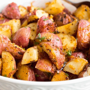 Garlic Parmesan Roasted Red Potatoes are an easy side you'll want to serve with all your favorite meals. From weeknights to holidays, they're a dinner win!