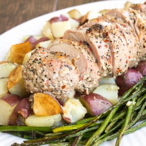 One Pan Pork Tenderloin with Asparagus & Potatoes is a delicious family-style meal that's easy enough for weeknights and special enough for holidays!