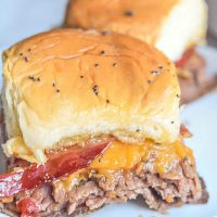 These Bourbon Bacon Roast Beef Sliders are a great game day recipe that is perfect for your next football party.