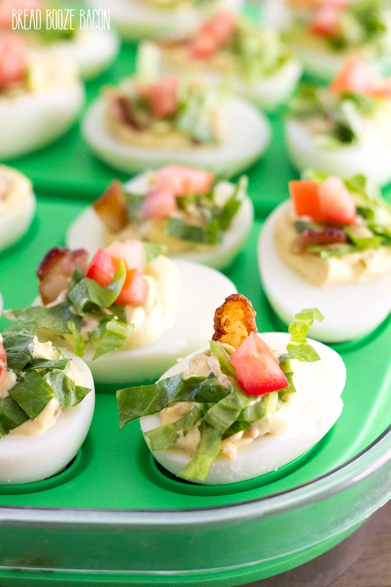 BLT Deviled Eggs are a poppable party bite loaded with bacon, lettuce, and tomato! Who needs a sandwich when you can have deviled eggs!