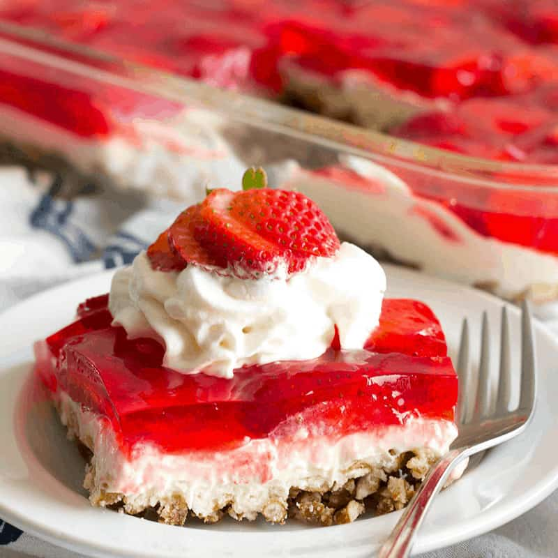 Strawberry Pretzel Salad is an easy dessert that's a party favorite! Layers of crunchy pretzels, luscious cream cheese mousse, and strawberries with jello are the best summer treat!