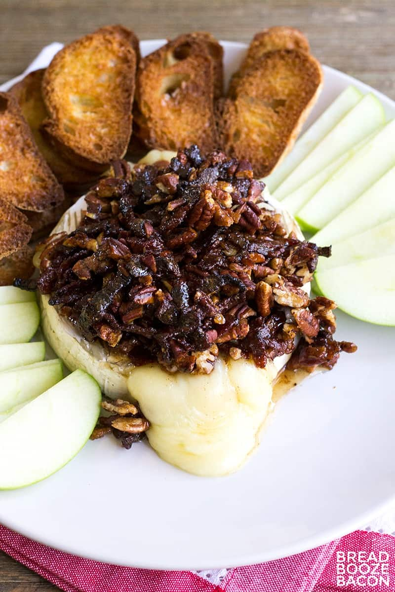 Ooey, gooey Bacon Pecan Baked Brie is the best bite for any occasion! Baking spices, salty bacon, nuts, and tangy brie are a match made in flavor heaven!