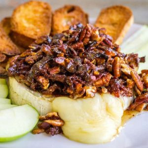 Ooey, gooey Baked Brie with Pecans and Bacon is the best bite for any occasion! Baking spices, salty bacon, nuts, and tangy brie are a match made in flavor heaven!