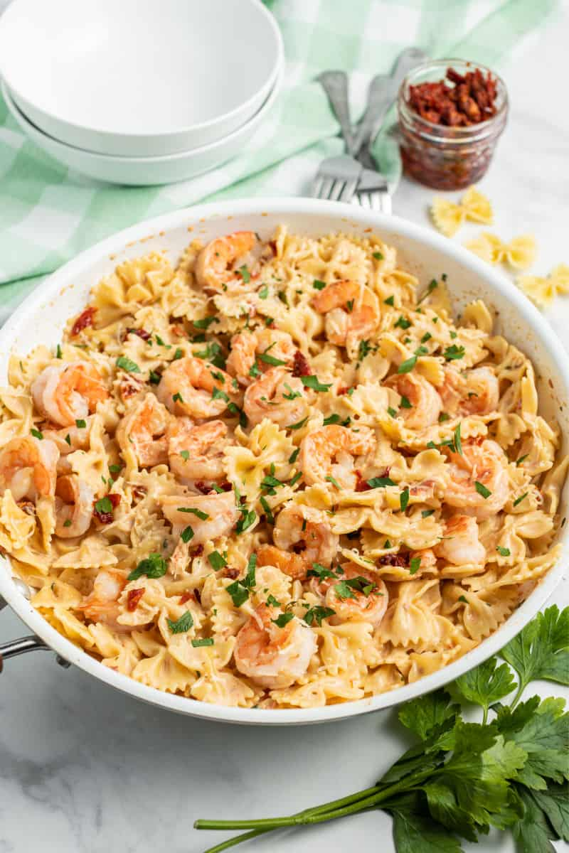skillet of balsamic shrimp pasta with sun dried tomato cream sauce