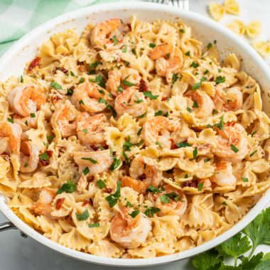 Sun-Dried Tomato & Balsamic Shrimp Pasta is a 15-minute dinner you'll crave! A creamy, tangy sauce pairs perfectly with sweet shrimp & savory tomatoes!