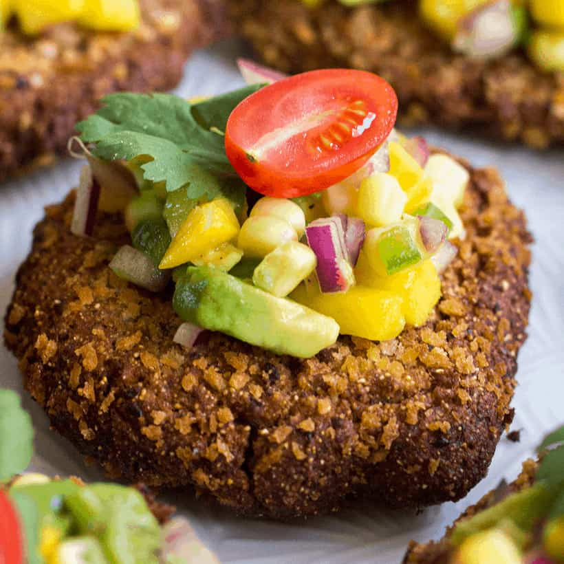Spice up your meal with Mexican inspired Black Bean Cakes with Corn-Mango Salsa! These crispy cakes are delicious, easy to make, and topped with a fresh salsa that'll make your taste budsdance!