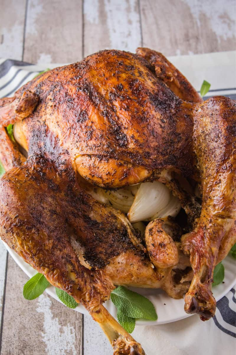 roasted thanksgiving turkey on a serving platter with sage