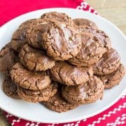 Chocolate Andes Mint Cookies are rich, minty and perfect for the winter season! The Andes mintsare a refreshing topping for these easy chocolate cookies!