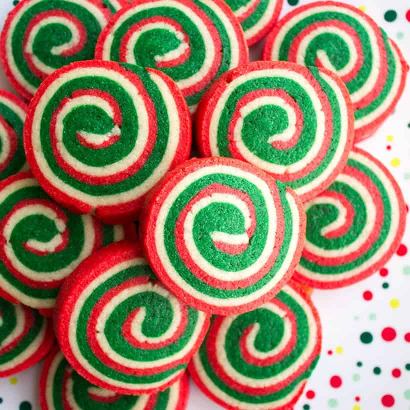 These Christmas Pinwheel Cookies are sure to be the star of your holiday cookie plates! Bring them to a cookie swap and watch everyone's eye light up!