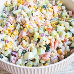 Fresh Vegetable Salad is a quick & easy recipe that's loaded with veggies and tossed in a creamy dressing making it the perfect side dish for potlucks!