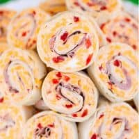 Ham & Pimento Cheese Pinwheels piled on a plate