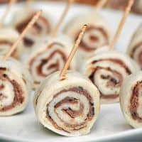 Garlic Roast Beef Pinwheels with toothpicks arranged on a palte