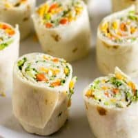 Vegetable Tortilla Roll Ups lined up on a platter